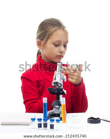 schoolgirl conducts research on a white background isolated