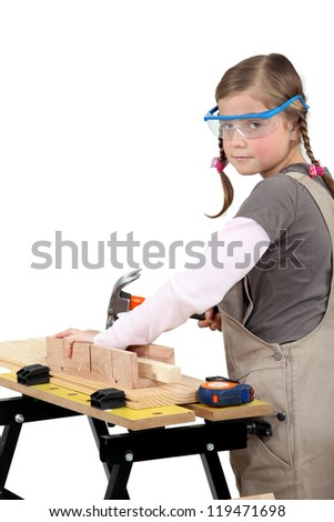 schoolgirl disguised as carpenter - stock photo