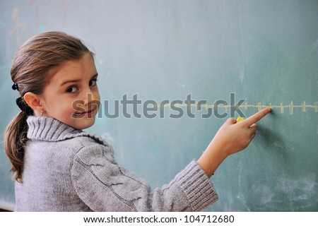 Schoolgirl draws a graph