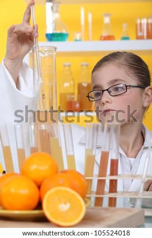 schoolgirl dressed as biologist - stock photo