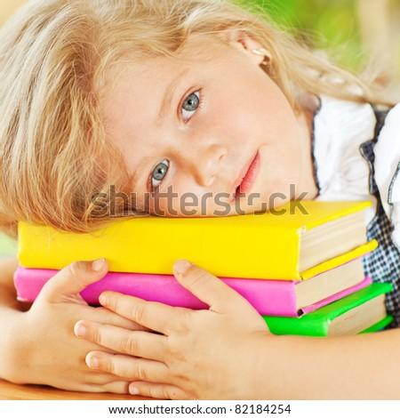 Schoolgirl girl reading books - stock photo
