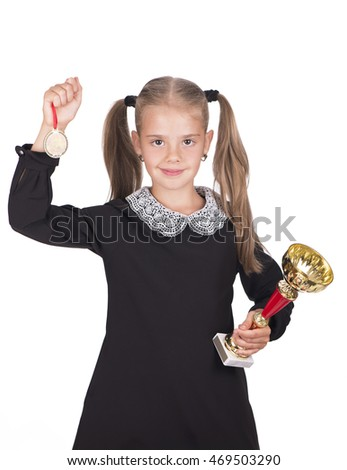 Schoolgirl holding a medal and a cup on a white background