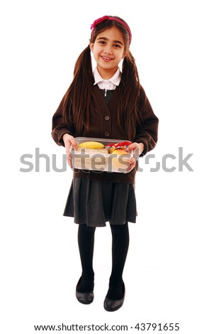 Schoolgirl holding healthy packed lunch isolated on white