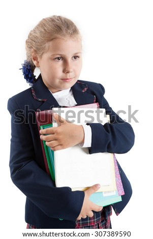 Schoolgirl holding textbooks on hands, isolated on white background - stock photo