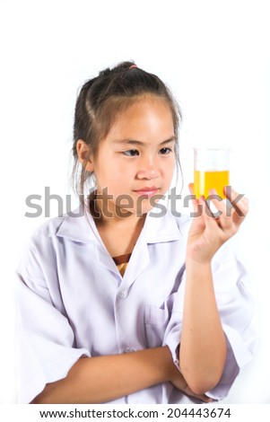 Schoolgirl in academic  chemical experiments, isolated on white