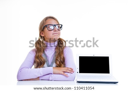 Schoolgirl in glasses, with her white netbook