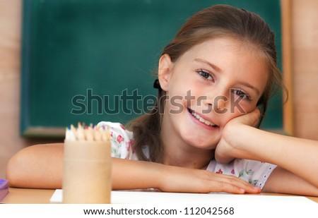 Schoolgirl in the classroom - back to school - stock photo