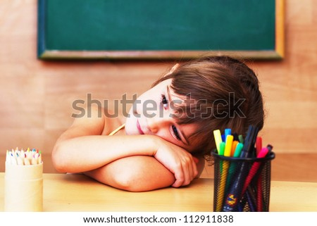Schoolgirl in the classroom - back to school - stock photo