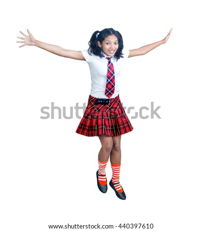 schoolgirl in uniform jumps on a white background - stock photo