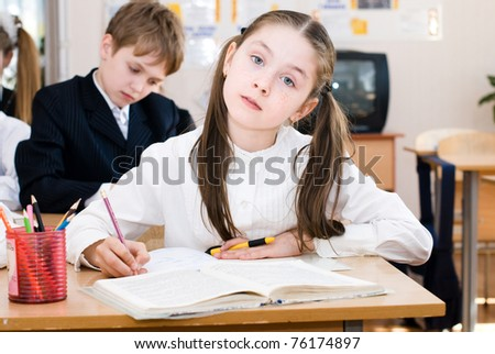 schoolgirl on the lesson in a classroom