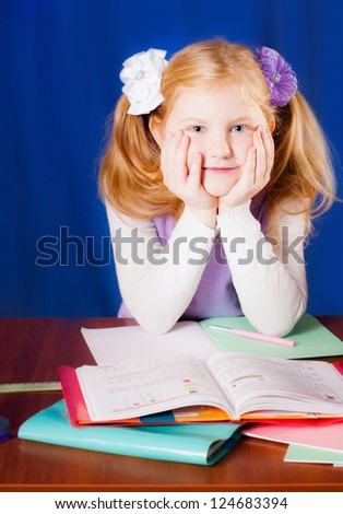 schoolgirl on the table - stock photo