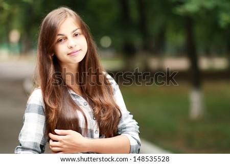 Schoolgirl Outdoor with book bag. Back to School. - stock photo