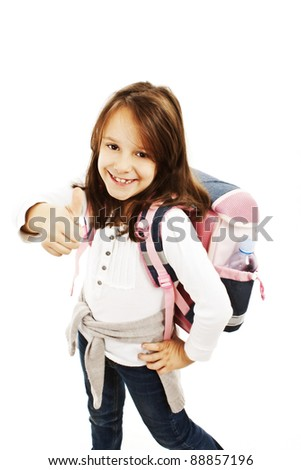 Schoolgirl showing OK sign isolated on white - stock photo