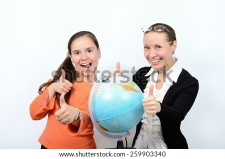 Schoolgirl teenager and a woman teacher with globe happy successful learning - stock photo