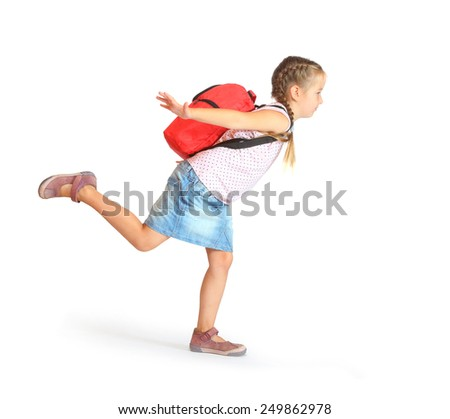 Schoolgirl with backpack going to holidays. - stock photo
