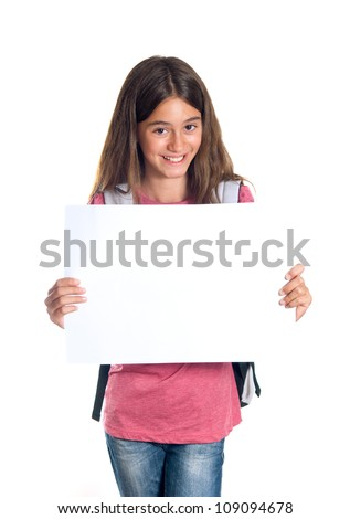 Schoolgirl with backpack holding a white sheet of paper - stock photo
