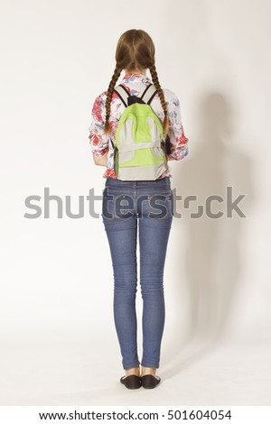 Schoolgirl with braids and backpack back portrait
