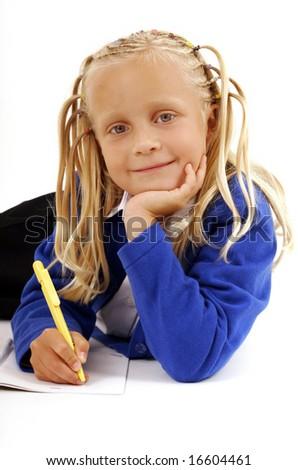 Schoolgirl writing in the notebook - stock photo
