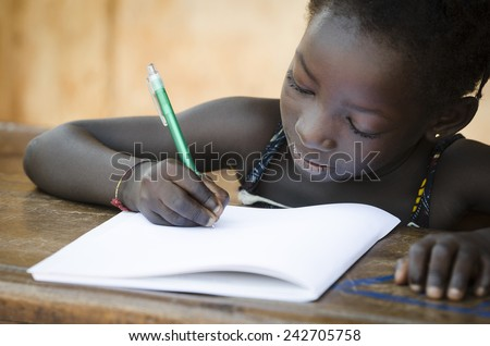 Schooling Symbol - African Young Girl Writing Notes (Real People) - stock photo
