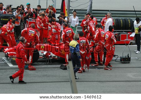 Schumacher On Grid with Pit Crew - stock photo