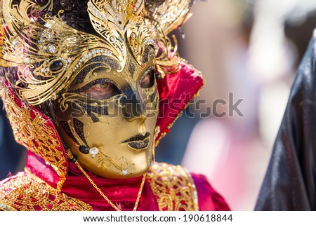 SCHWAEBISCH-HALL, GERMANY - February 23, 2014 - Woman, dressed up in a Venetian style costume with a golden mask attends the Hallia Venetia Carnival festival on February 23, 2014 in Schw�¤bisch-Hall.