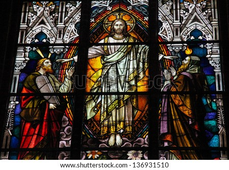 SCHWERIN, GERMANY - APRIL 12:  Stained glass window depicting Jesus Christ, Moses with the Ten Commandments and the Prophet Iesaiah in the cathedral of Schwerin, Germany on April 12, 2013. - stock photo