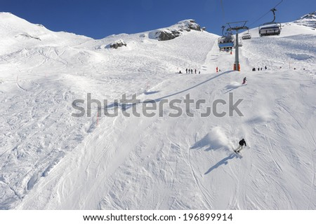 Sci slope and cableway of Engelberg on the Swiss alps