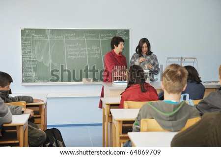science and chemistry classees at school with smart children and teacher