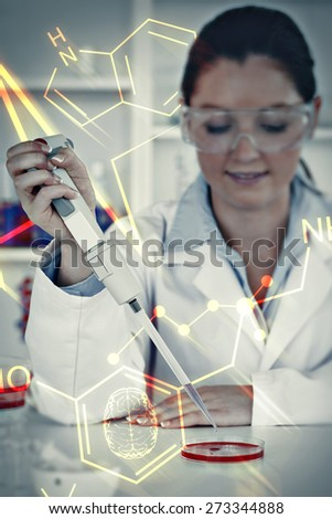 Science and medical graphic against portrait of a young scientist preparing - stock photo