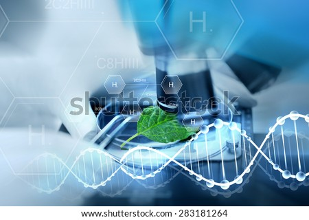 science, chemistry, biology and people concept - close up of scientist hand with microscope and green leaf making research in laboratory over hydrogen chemical formula and dna molecule structure - stock photo