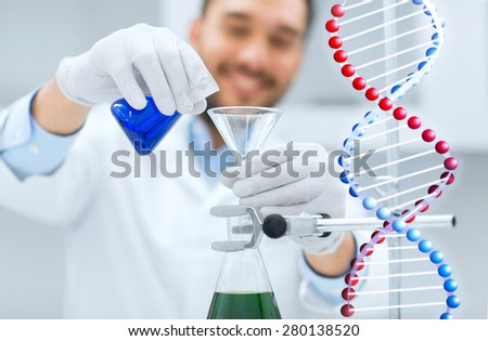 science, chemistry, biology, medicine and people concept - close up of scientist filling test tubes with funnel and making research in clinical laboratory - stock photo