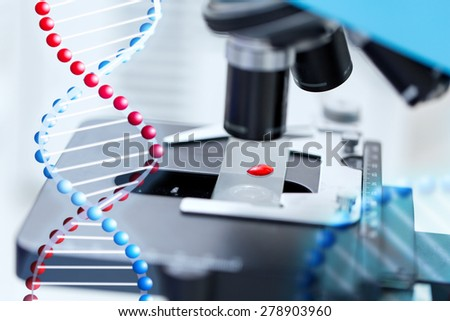 science, chemistry, biology, medicine and research concept - close up of microscope with blood test sample in clinical laboratory - stock photo