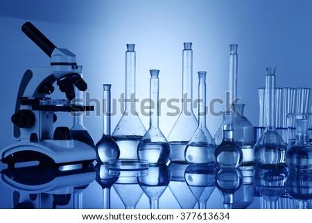 Science concept, Chemical laboratory glassware, microscope  - stock photo