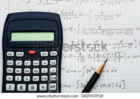 Science concept - handheld calculator and pencil over a sheet of paper with maths-formulas - stock photo