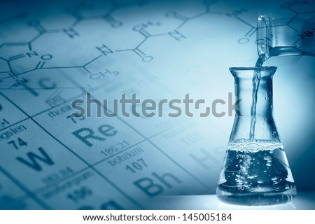 Science concept,Pouring liquid into flask. - stock photo