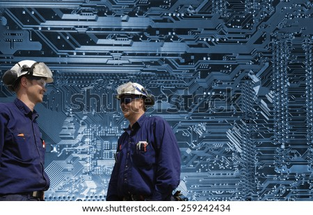 science engineers with giant futuristic circuit-board in background - stock photo