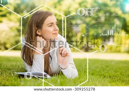 science formula against smiling university student lying and thinking - stock photo