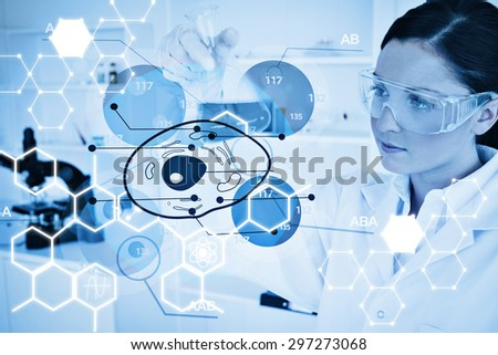 Science graphic against chemist examining cell interface - stock photo