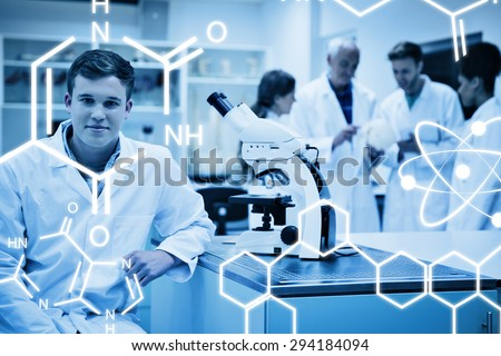 Science graphic against happy medical student working with microscope - stock photo