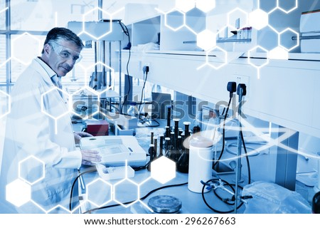 Science graphic against scientist carrying out an experiment looking at the camera