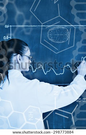Science graphic against scientist drawing a graph on the blackboard - stock photo