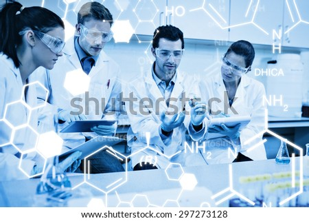 Science graphic against scientists with tablet pc working on an experiment at lab - stock photo