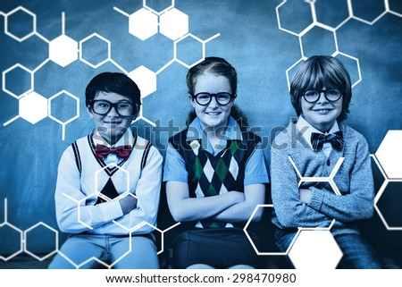 Science graphic against smiling little school kids in classroom - stock photo