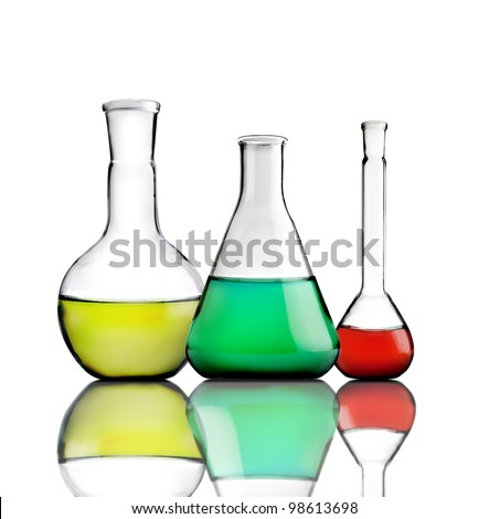 Science lab bottles with colored liquids inside