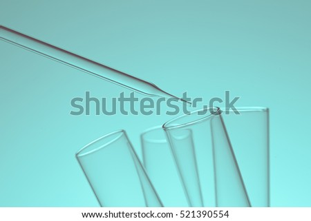 science laboratory dropper on test tube  , pharmaceutical research equipment in lab  , science concept