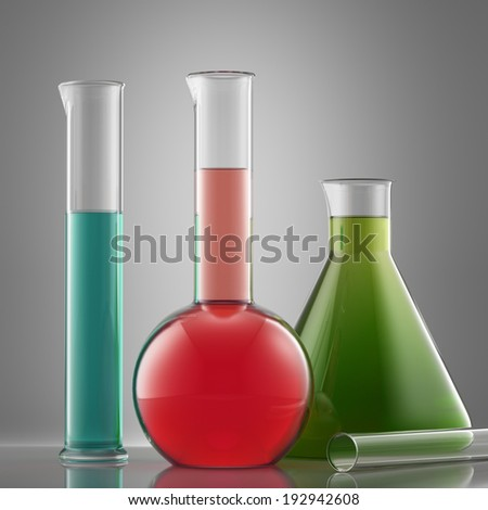 Science laboratory glass equipment with liquid. flasks with color liquid - stock photo