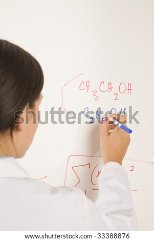 science professional writing on white board