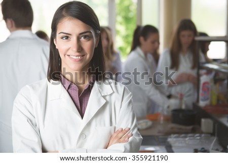 Science students working with chemicals in the lab at the university.Happy student, content for experimental results.Pharmacy.Young medicine developer pharmaceutical researcher - stock photo