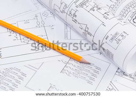 Science, technology and electronics. Electrical engineering drawings printing with pencil. Scientific development.