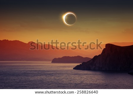 Scientific background, astronomical phenomenon - full sun eclipse, total solar eclipse, mountains and sea - stock photo